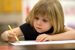 113730580-1st-grade-girl-in-class-gettyimages